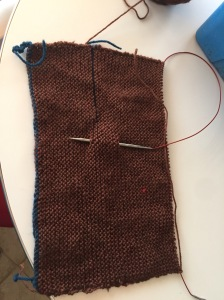 brown knit rectangle  of knitting